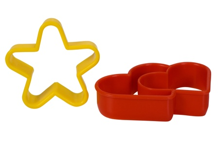 Close-up of a star and a heart shaped cookie cutters