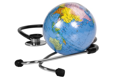 Close-up of a globe with a stethoscope photo