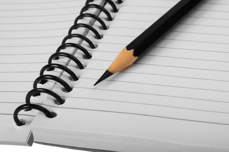 things that go together: Close-up of a pencil on a spiral notebook