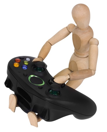 pus: Artists figure with a video game controller Stock Photo
