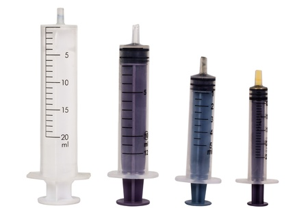 Close-up of assorted medical syringes photo