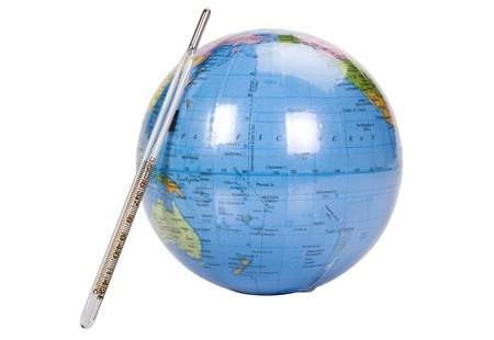 Close-up of a globe with a thermometer photo