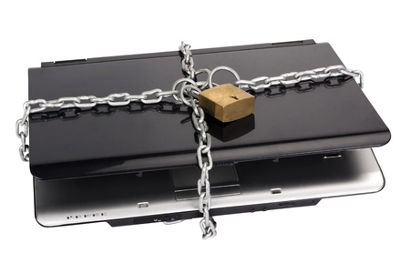 Laptop tied with chain and a padlock Stock fotó