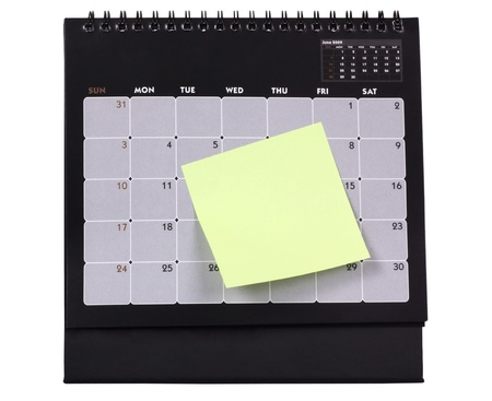 mnemonic: Adhesive note attached with a calendar Stock Photo