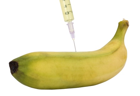 Syringe being injected into a banana