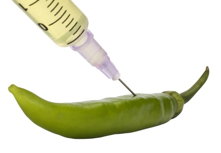 Green bell pepper being injected with a syringe Stock Photo - 10235072