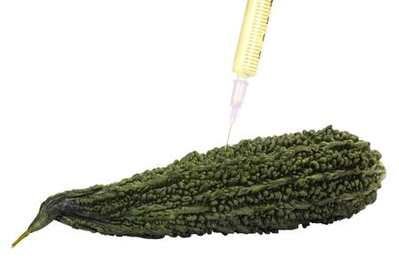 Bitter melon being injected with a syringe Stock Photo - 10252911