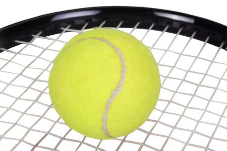 things that go together: Close-up of a tennis racket with a tennis ball