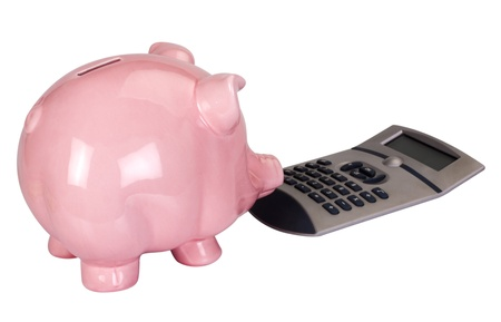 Close-up of a piggy bank with a calculator Stock Photo - 10235278