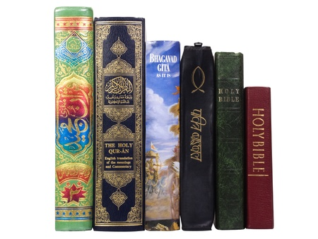 western script: Assorted religious books in a row