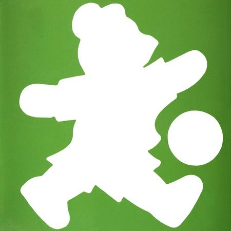 Silhouette d'un ours en peluche jouant avec un ballon de soccer Banque d'images - 10238400