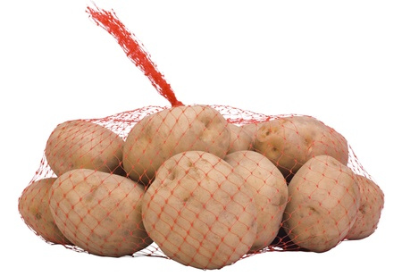 Close-up of raw potatoes in a net bag Stock Photo