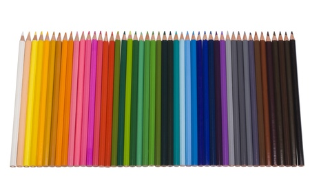 Close-up of colored pencils in a row Imagens
