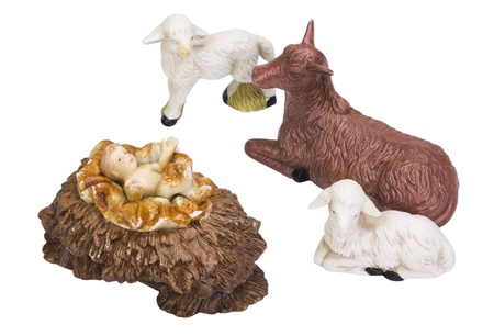 named person: Figurines of animals near baby Jesus Stock Photo