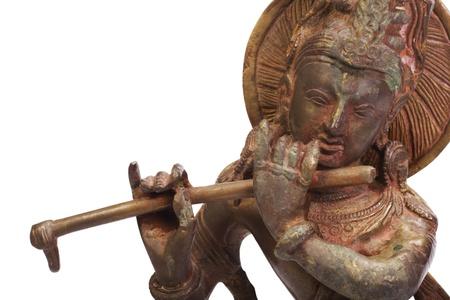 Close-up of a figurine of Lord Krishna