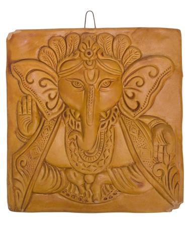 Lord Ganesha engraved on a wooden block photo