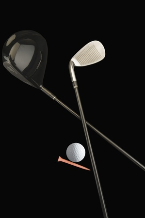 Close-up of golf clubs with a golf ball photo