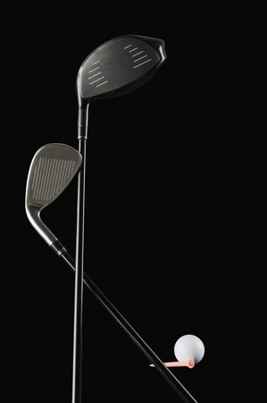 things that go together: Close-up of golf clubs with a golf ball Stock Photo