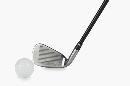 things that go together: Close-up of a golf club with a golf ball