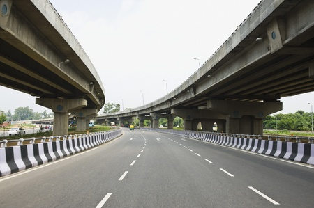 city street: Road in the middle of overpasses, National Highway 8, New Delhi, India Stock Photo