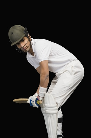 Cricket batsman playing cricket photo