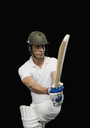 Cricket batsman playing a pull shot photo