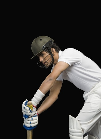 Cricket batsman in forward defensive stance photo
