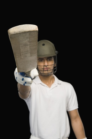 batsman: Cricket batsman raising his bat Stock Photo