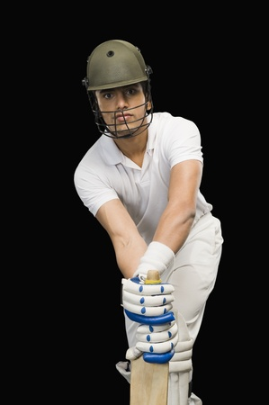 stance: Cricket batsman in forward defensive stance Stock Photo