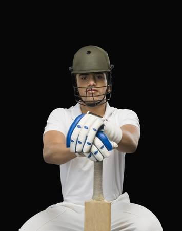 cricket bat: Portrait of a cricket batsman with a cricket bat