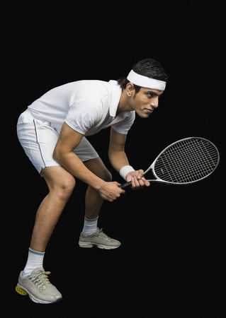tennis racket: Tennis player practicing with a tennis racket Stock Photo