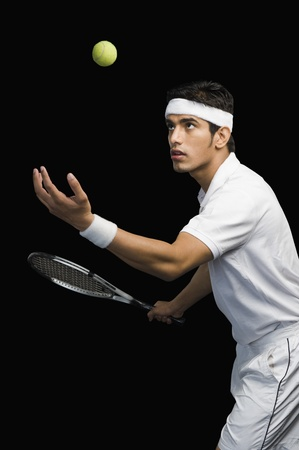 Tennis player serving photo