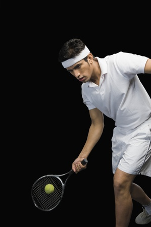 Tennis player playing a shot Stock Photo - 10253050