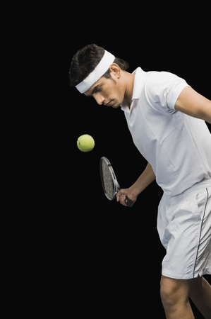 Tennis player playing a shot photo