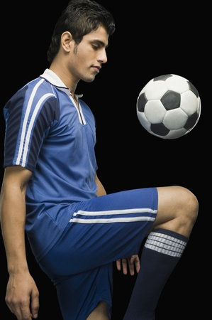 Soccer player practicing with a soccer ball
