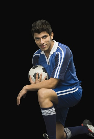 Portrait of a soccer player with a soccer ball photo