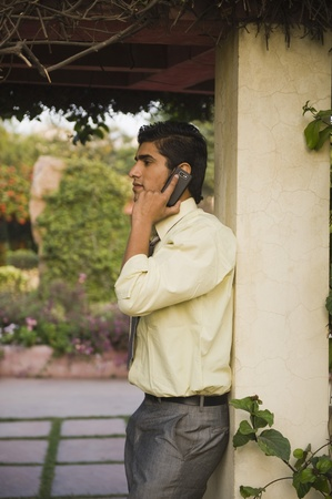 Businessman talking on a mobile phone photo