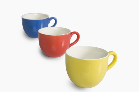 Close-up of colorful tea cups in a row photo