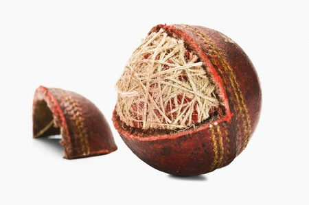 Close-up of a worn out cricket ball