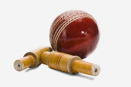 cricket ball: Close-up of a cricket ball and bails
