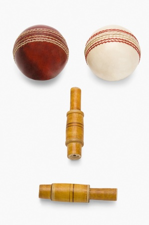 cricket ball: Cricket balls and bails forming an anthropomorphic face