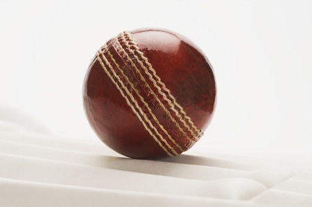 cricket ball: Close-up of a cricket ball on a cricket pad Stock Photo