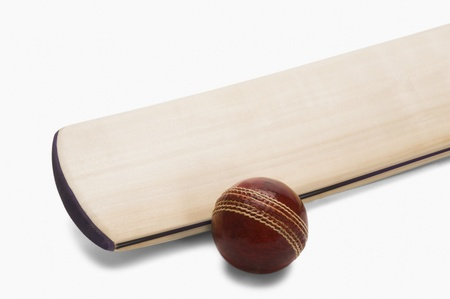 Close-up of a cricket ball with a bat photo