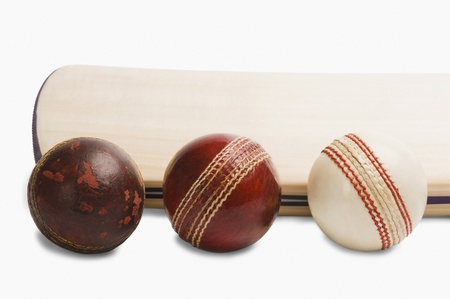 cricket ball: Close-up of cricket balls with a bat