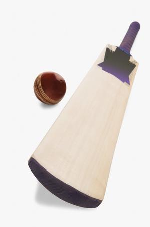 cricket ball: Close-up of a cricket ball with a bat