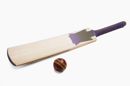 bat and ball: Close-up of a cricket ball with a bat