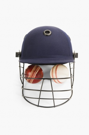 cricket helmet: Close-up of cricket balls under a cricket helmet Stock Photo