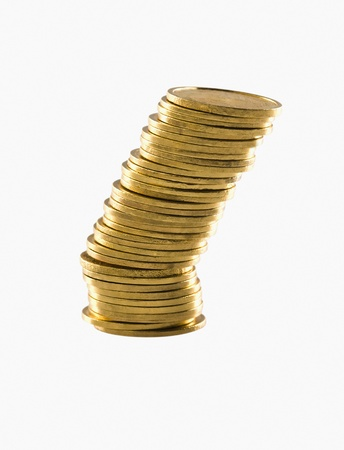 coins shot in golden color: Stack of gold coins Stock Photo