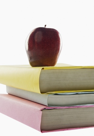 Apple on top of stacked books photo