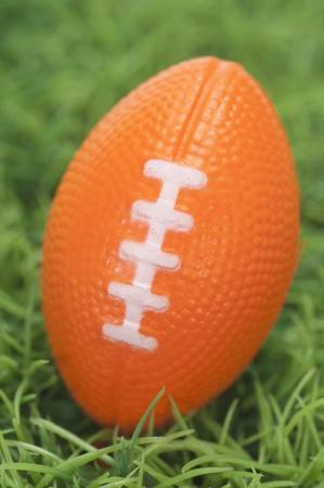 芝生の上のアメリカン フットボールのクローズ アップ 写真素材